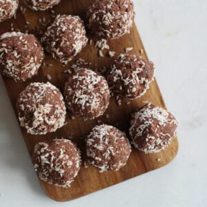 protein balls on a wooden board