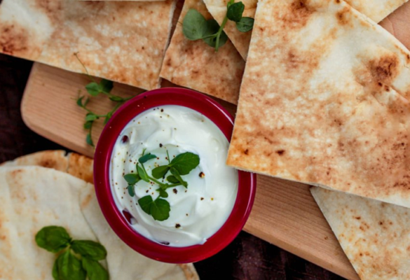homemade pita bread with a herby dip
