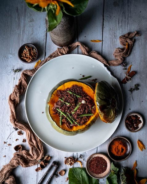 CROWN PRINCE SQUASH STUFFED WITH FINE BEANS WALNUTS AND QUINOA