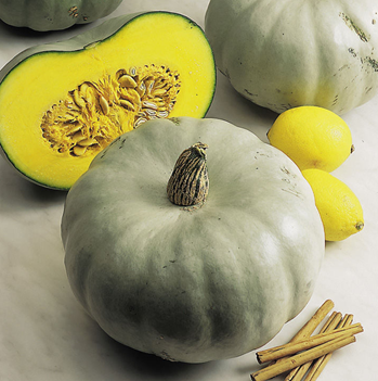 crown prince squash, one in half and a whole one