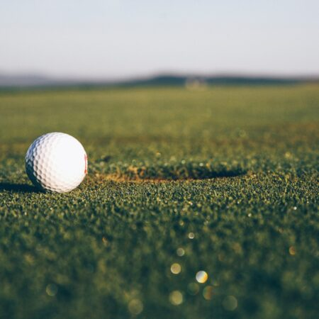 golf ball next to a hole