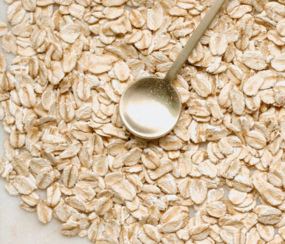 oats on a table with a golden spoon