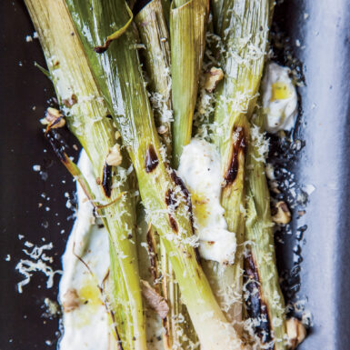 Leeks topped with grated walnut
