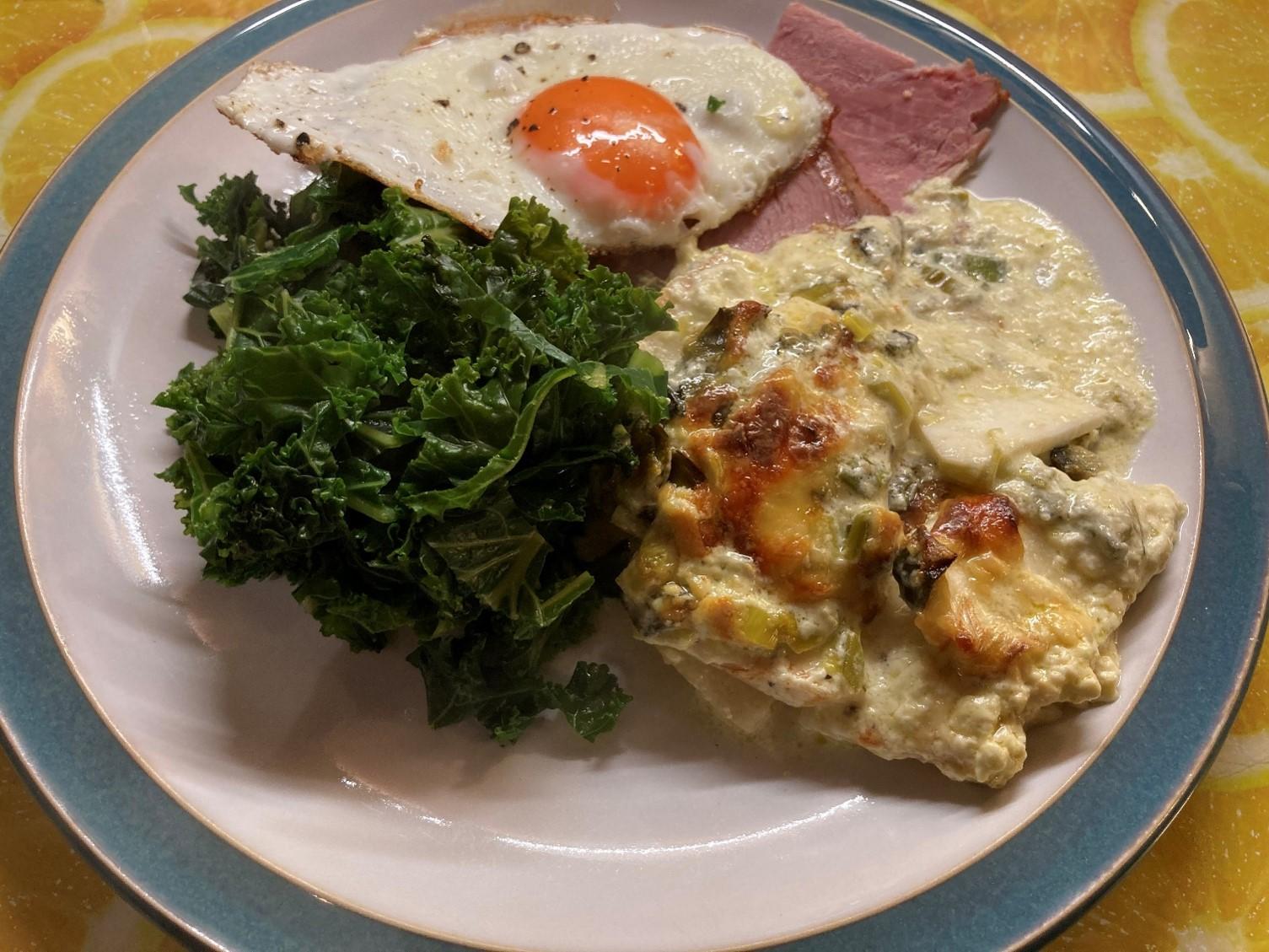 celeriac gratin with ham, fried egg and kale