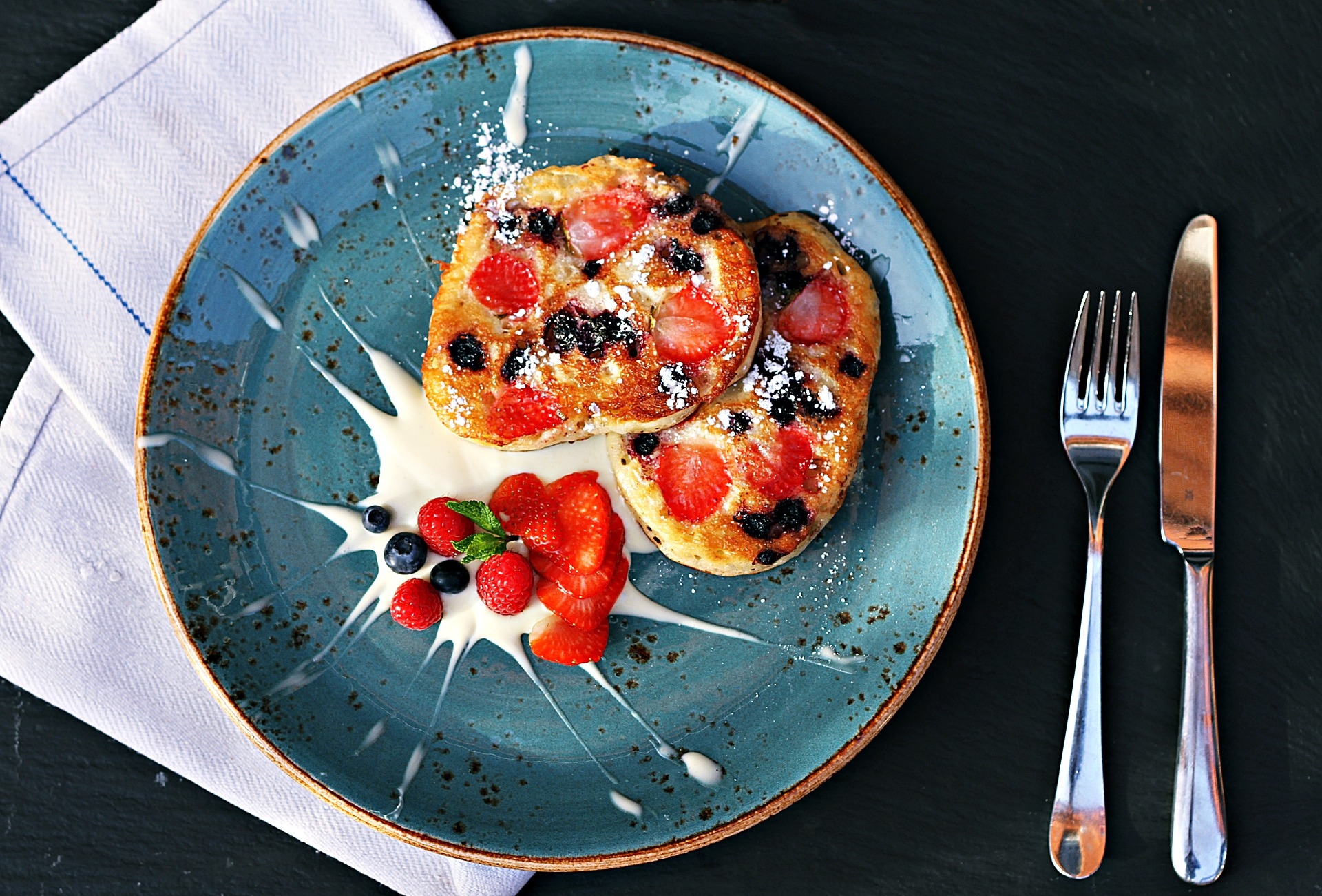Strawberry and blueberry pancakes with cream