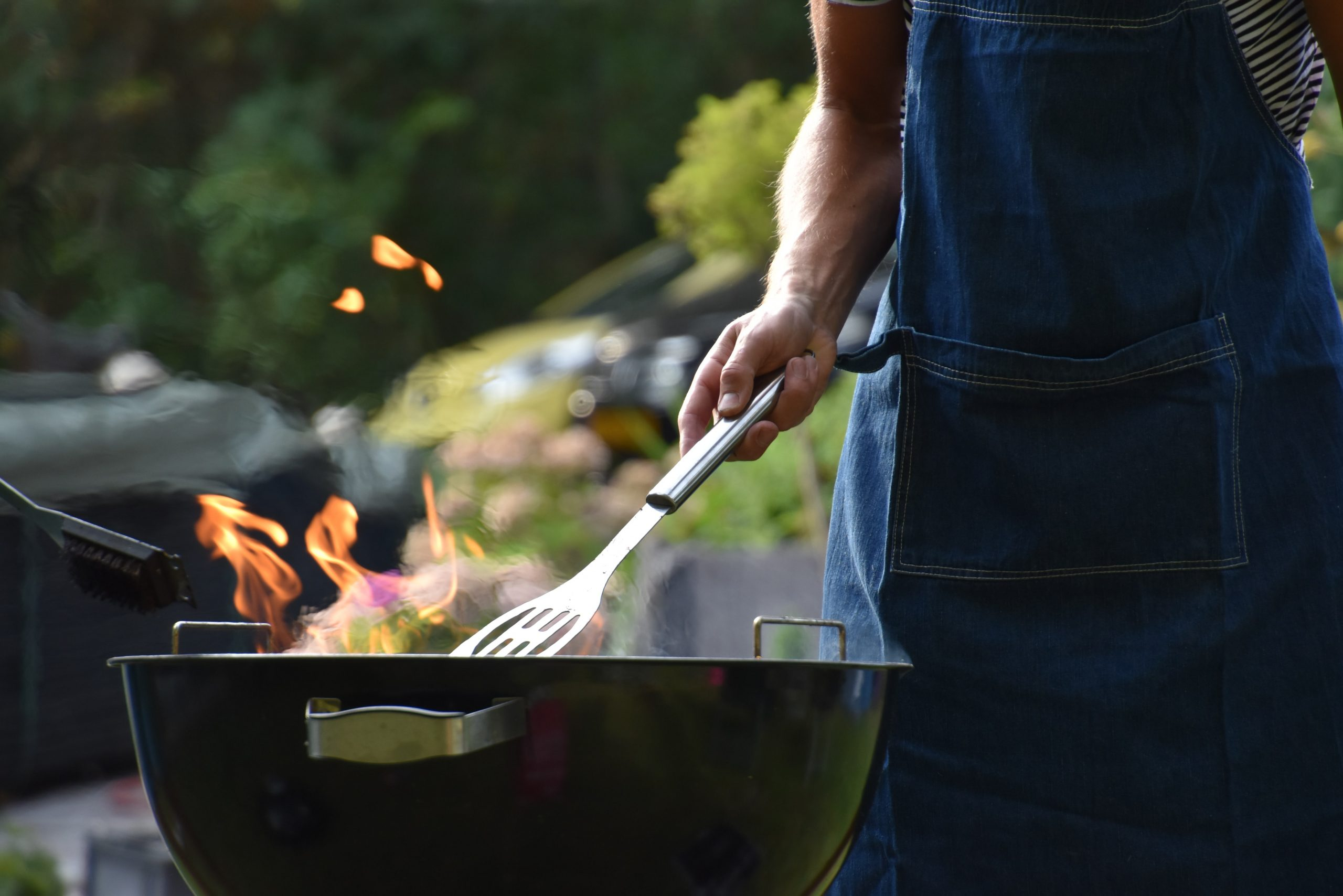 A man barbecuing