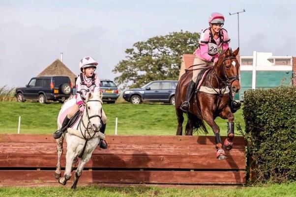 Lucinda Fredericks riding on a horse